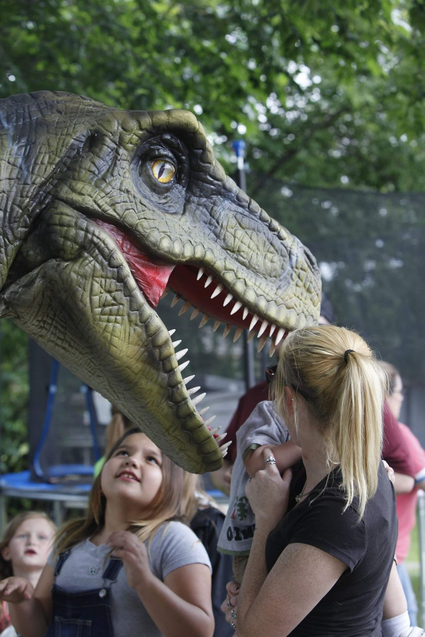 Pictured is Norman the dinosaur while entertaining children at a birthday party. (Credit: Krysti Burton)