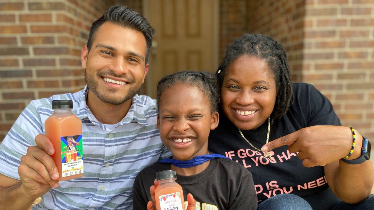 Pictured is Spectrum News 1 Texas human interest reporter Lupe Zapata and owners of EE Healthy Juicy Juice, 7-year-old E'Syntheis Chambers and his mother Roshanda White. The organic juice business is based in DeSoto, Texas. Credit, Lupe Zapata