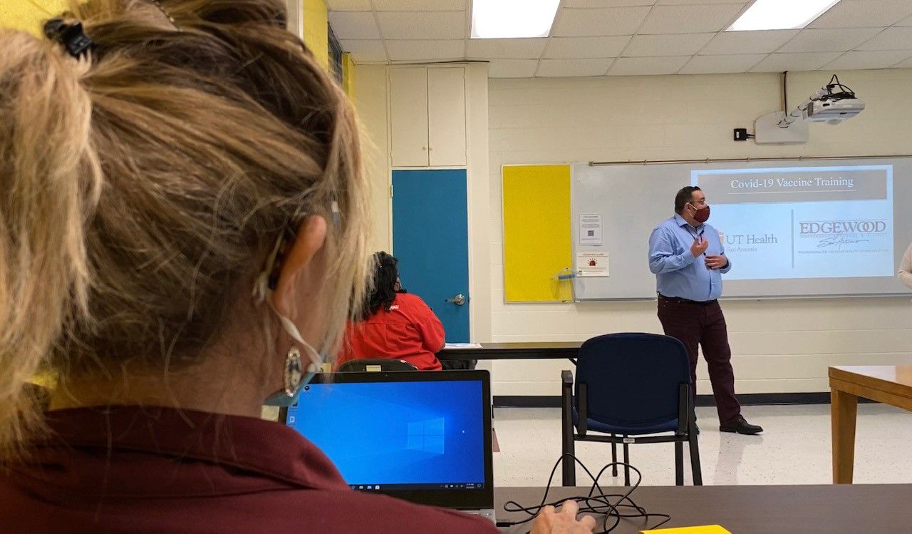 George Garnica goes over a presentation on the vaccines with Edgewood ISD employees (Spectrum News 1)
