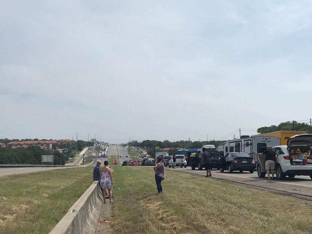Fiery crash, false bomb report bring I-35 to standstill