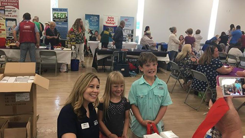 Meteorologist Juli Marquez talks to attendees at the Auburndale Hurricane Expo Saturday. (Debbie Clues, Spectrum News)