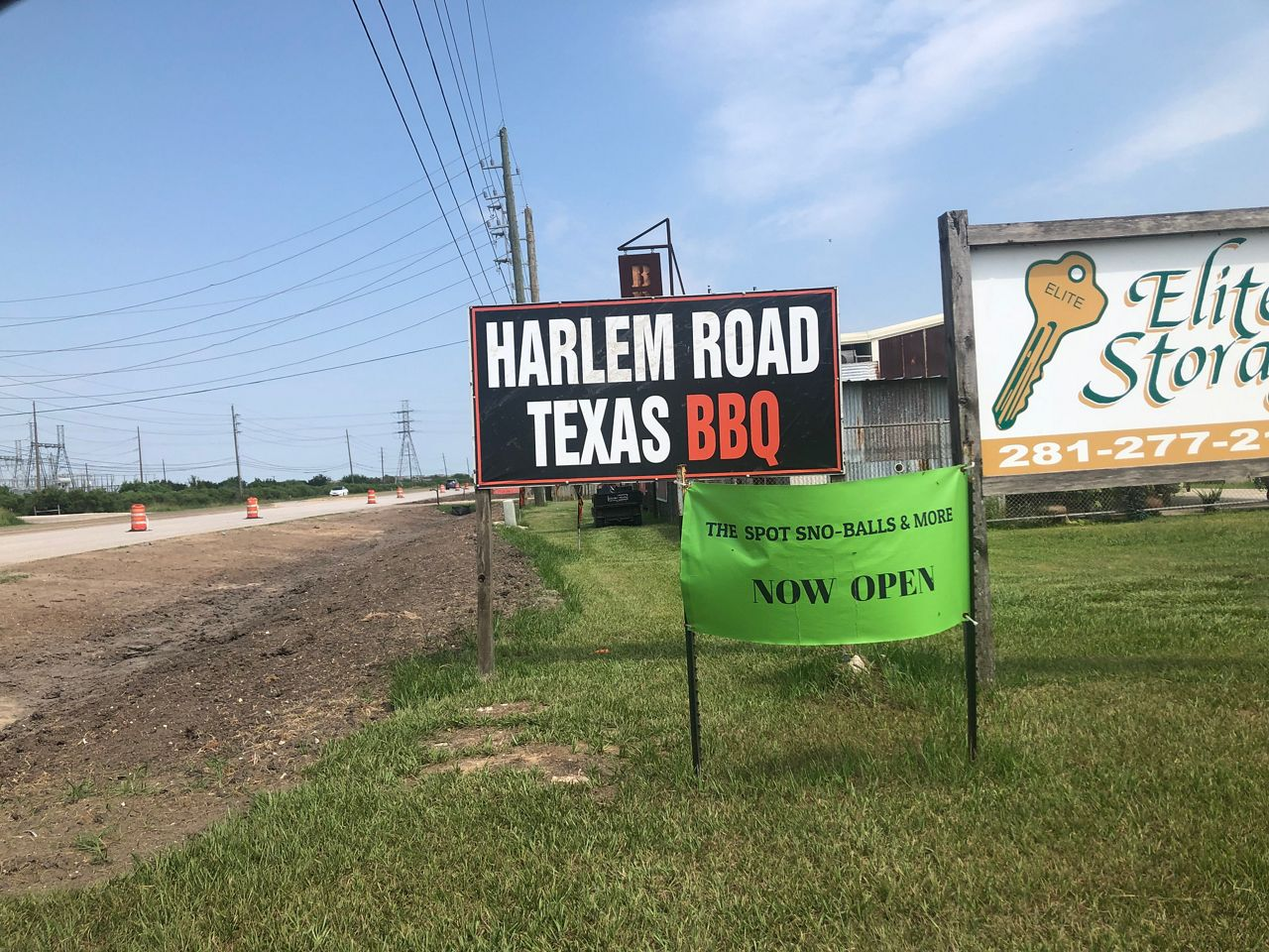 Photo shows signs neat Road Texas Barbecue. (Bryan Boes/Spectrum News)