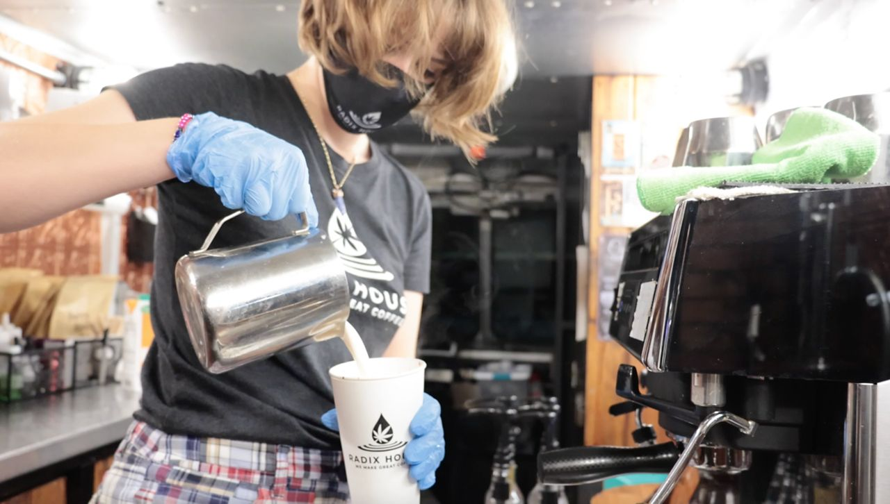A person pours coffee (Lakisha Lemons/Spectrum News 1)