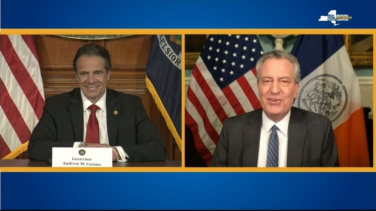 mayor deblasio and governor cuomo on split-screen TV