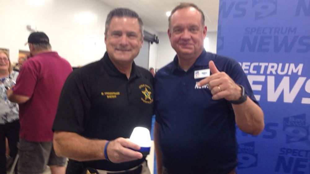 Chief Meteorologist Mike Clay with Citrus County Sheriff Mike Prendergast. (Deirdre Treacy, Spectrum News)