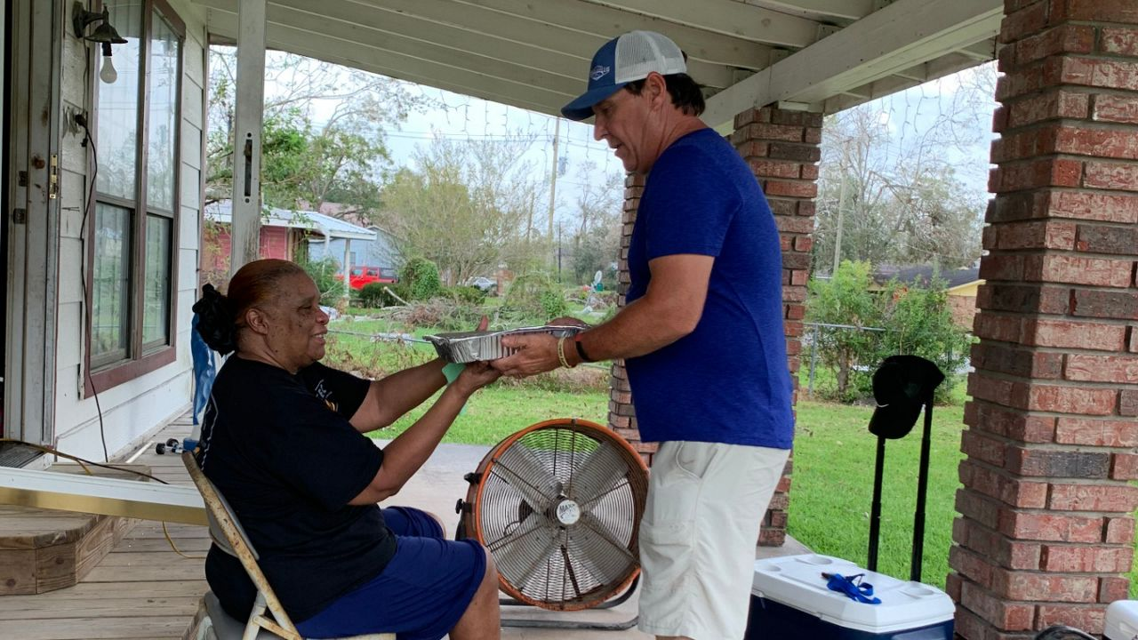 Brian Dunigan delivers food to a resident of DeQuincy, La. (Photo courtesy of Brian Dunigan.)