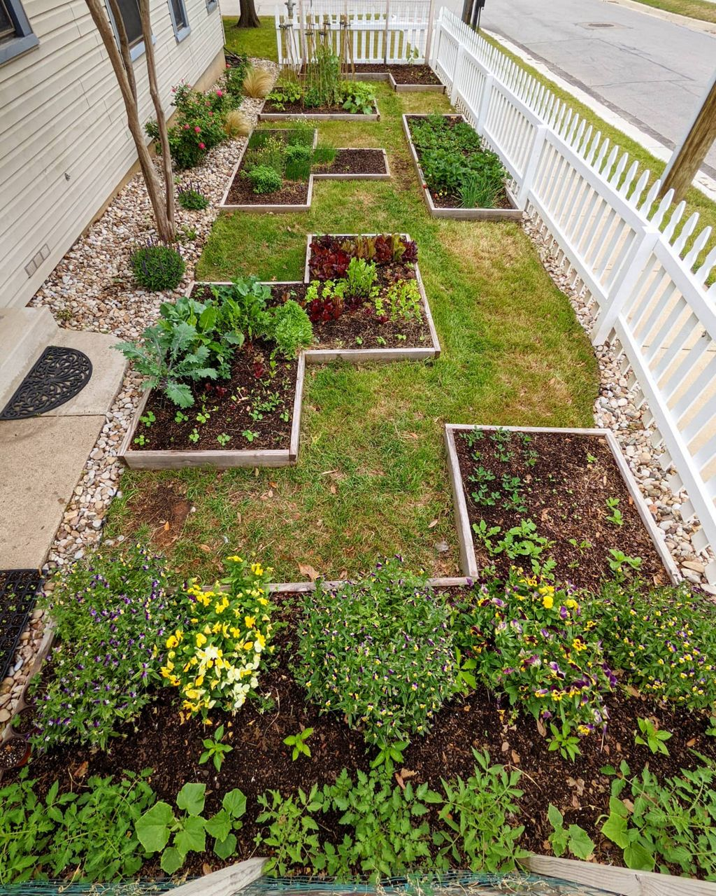 Pictured are the six planters built by Nathan Coughey in the front yard of his family's home in Fort Worth, Texas. (Courtesy: Tara Coughey)