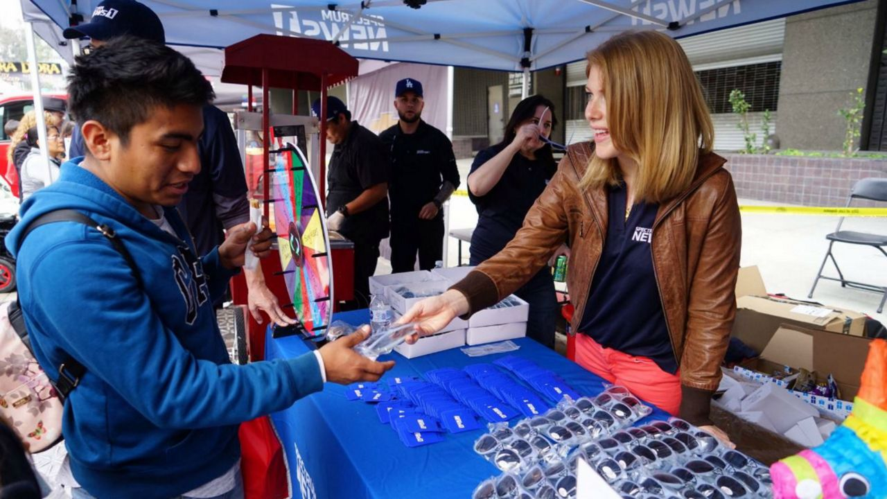 Kate Cagle with Spectrum News 1 meets viewers at Fiesta Broadway on April 28, 2019