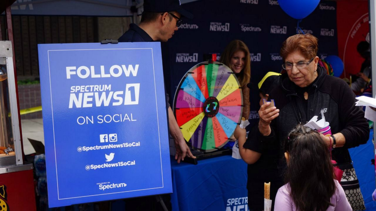 Spectrum News 1 booth at Fiesta Broadway on April 28, 2019