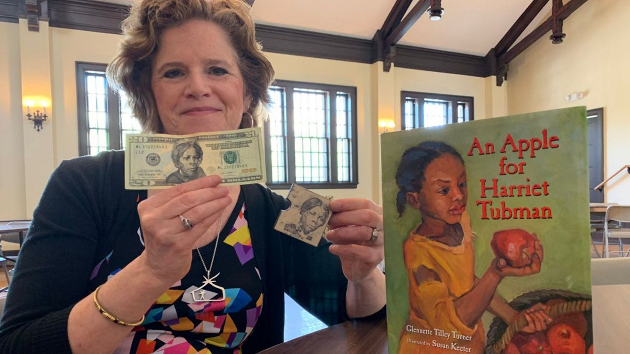 Artist Uses Harriet Tubman Stamp To Transform 20 Bill