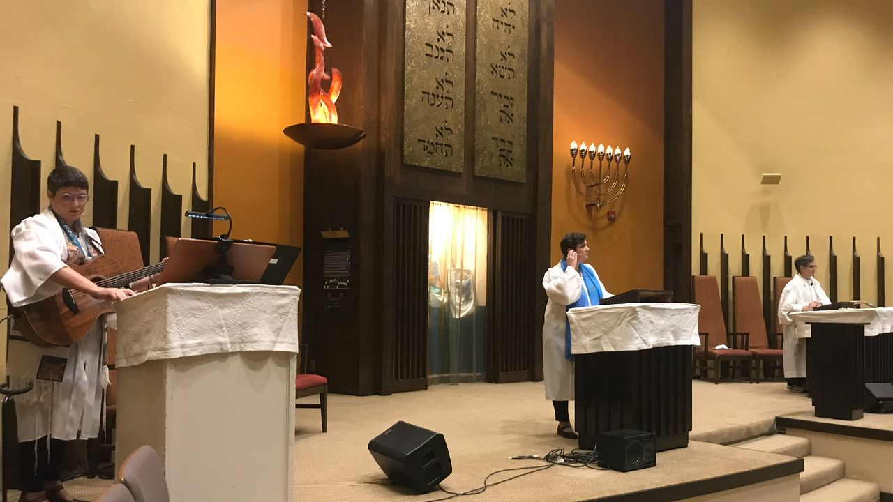 Rabbis and a cantorial soloist at Congregation Beth Israel in Austin (Matt Mershon/Spectrum News)