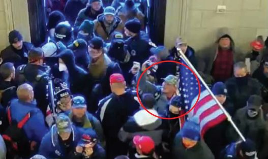 A video still purports to show suspect Jason Lee Hyland, circled, inside the U.S. Capitol during the riot on January 6, 2021. (Source: U.S. District Court for the District of Columbia)