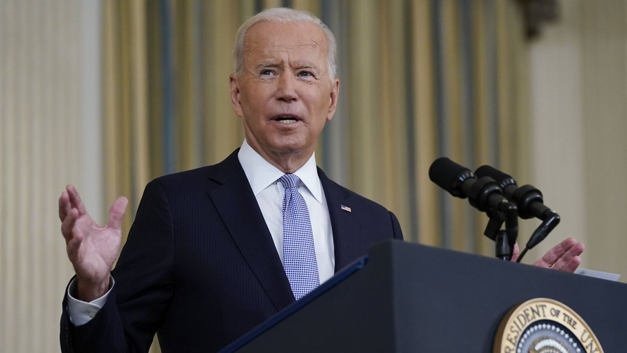 President Joe Biden speaks about the COVID-19 response and vaccinations in the State Dining Room of the White House on Friday. (AP Photo/Patrick Semansky)