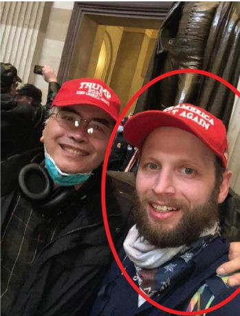 Garret Miller, right, poses with another Trump supporter in the U.S. Capitol Rotunda in this image from January 6, 2021. (Source: United States District Court for the District of Columbia)