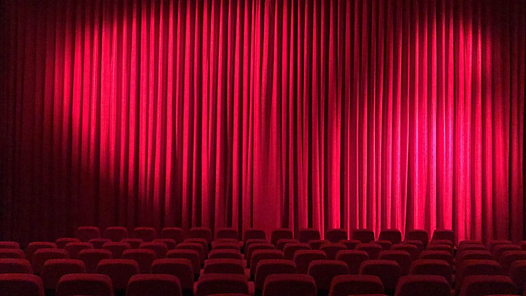 File Photo Of An Empty Movie Theater With A Red Curtain In Front The Screen