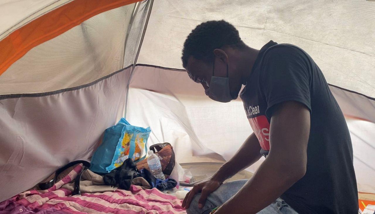 Ibrahima Kalil Diallo prays in this tent. (Spectrum News 1/Adolfo Muniz)
