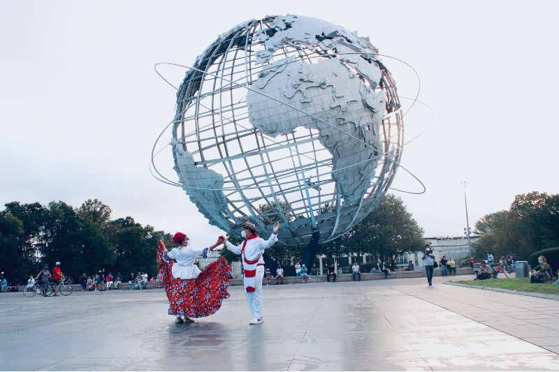 Two dancers performing together outside in public space in New York City.