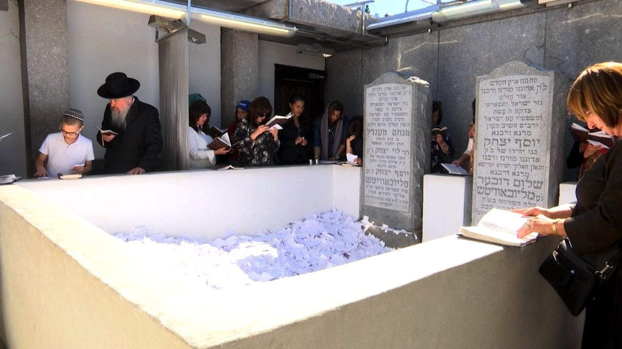 Members of All Faiths Seek Solace at Rebbe Gravesite