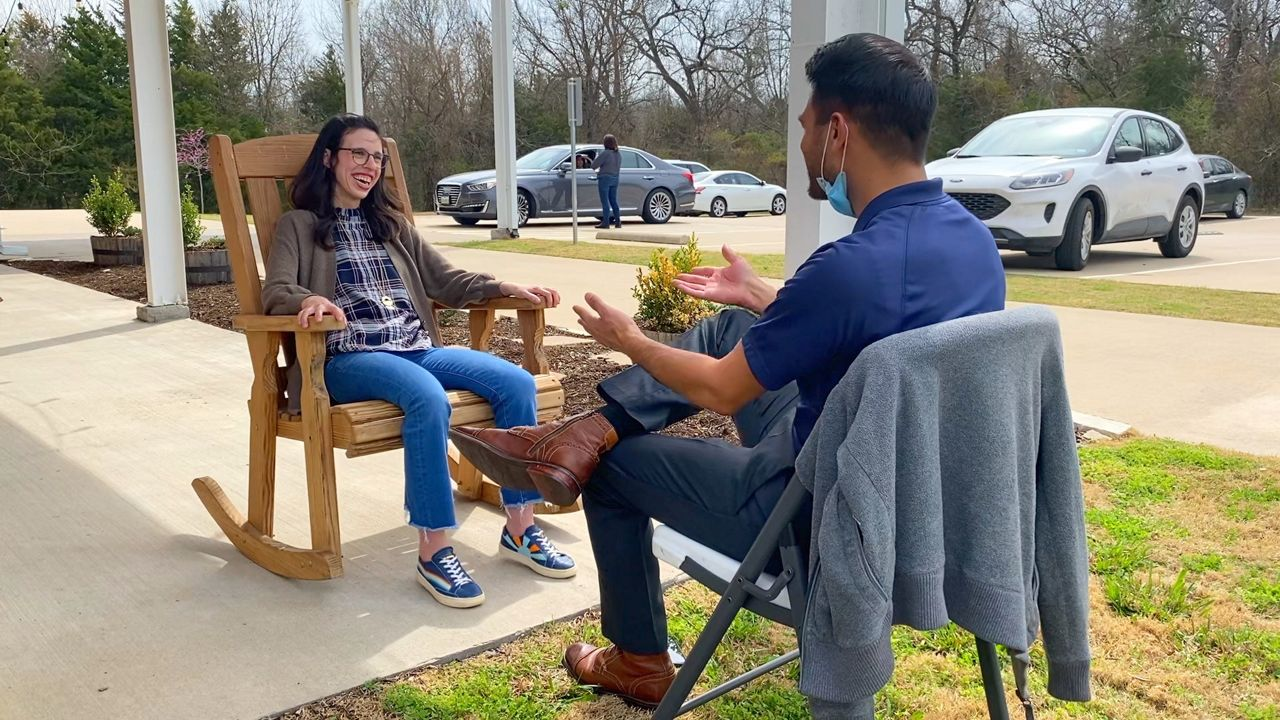 Avery Figueroa sits with Spectrum News 1 Reporter Lupe Zapata during an interview at Cornerstone Ranch. (Lupe Zapata/Spectrum News)