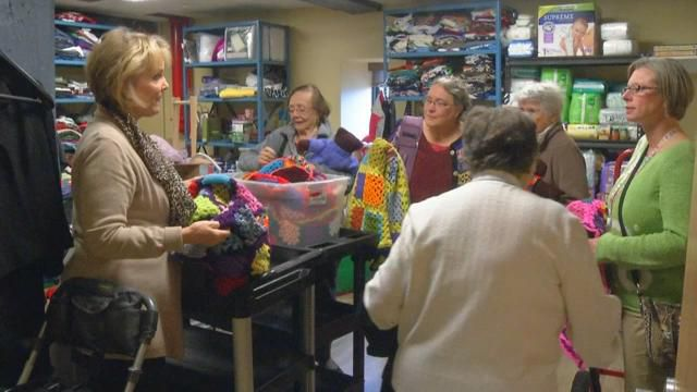 Group Donates Hand-Knit Goods to Children for Holiday Season