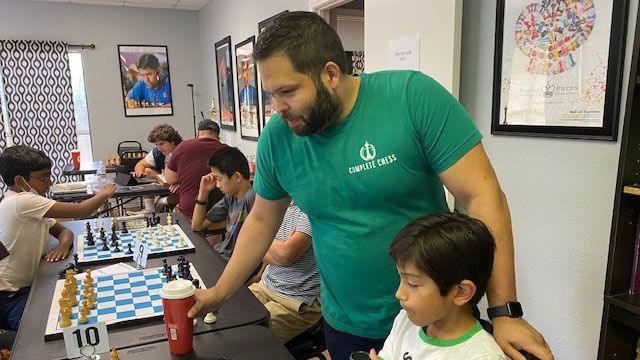 Jesse James Lozano works with a student at Complete Chess in San Antonio.