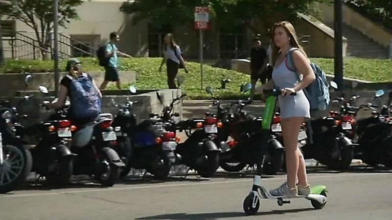 A passenger rides a LimeBike in Austin