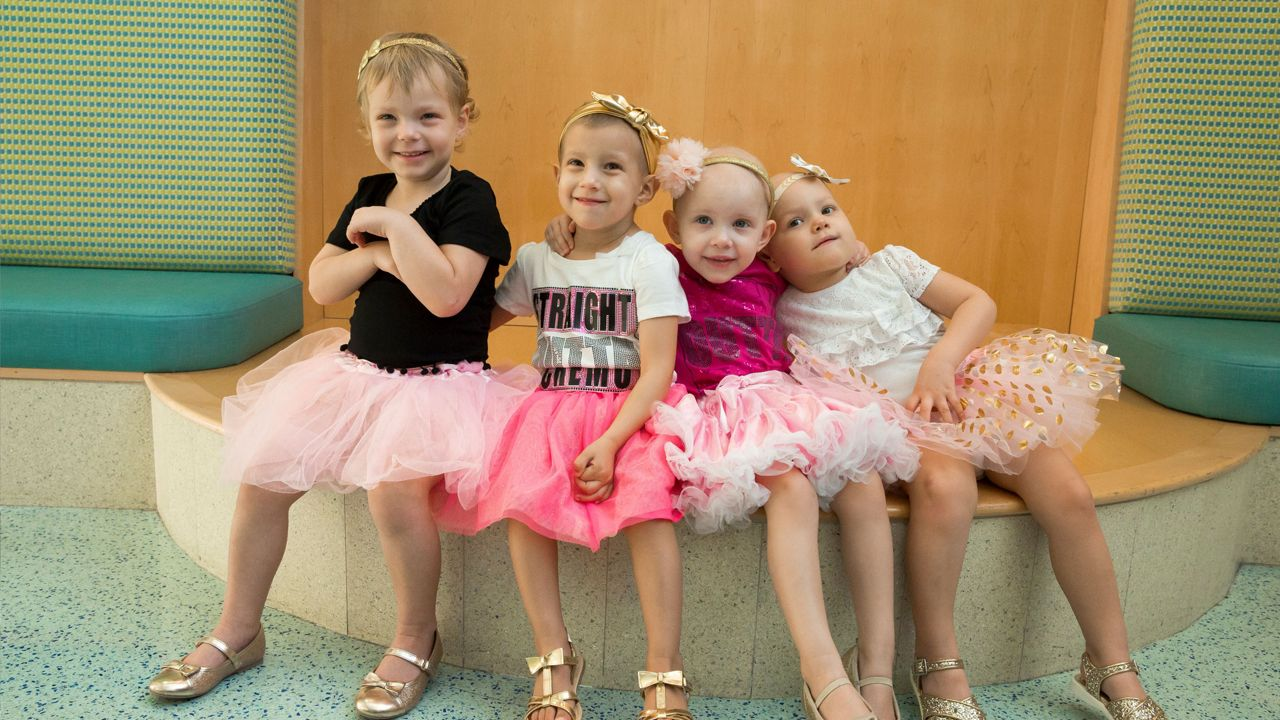 """Celebrating National Childhood Cancer Awareness Month and """"TuTu Tuesday"""", McKinley, Chloe, Lauren, and Avalynn, in the lobby of the hospital. The children are freinds from the Johns Hopkins All Children's Cancer & Blood Disorders Institute."""