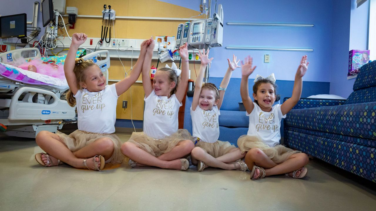 The 2019 tutu girl reunion was a special day for Lauren, McKinley, Ava and Chloe. The girls returned to Johns Hopkins All Children's Hospital's Cancer & Blood Disorders Institute to support their fellow warrior, Lauren, the day after her CAR-T therapy. Photo: Allyn DiVito/Johns Hopkins All Children's Hospital