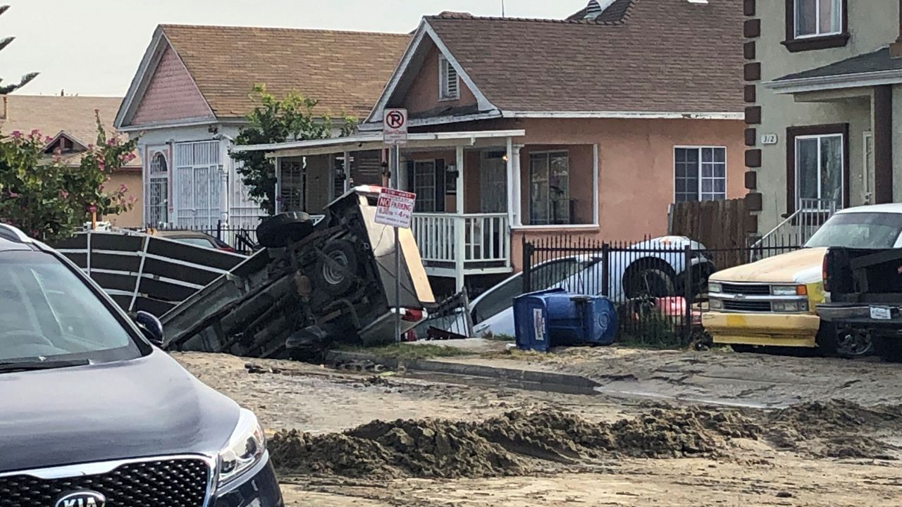 A broken water main caused extensive damage in South LA