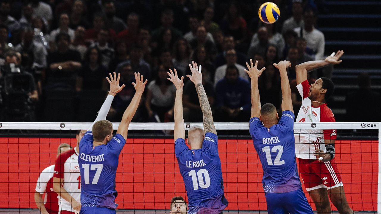 Wilfredo Leon, right, spikes the ball against France in 2019. (AP Photo, File)