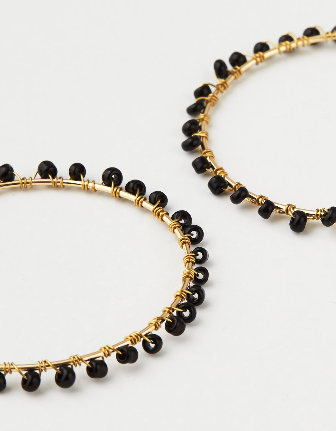AE Black & Gold Seed Bead Hoop Earring