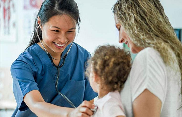 Healthcare provider assisting child patient