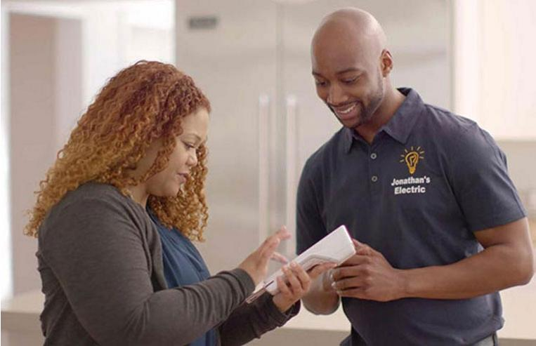 Service technician and customer with Clover Flex from Bank of America Merchant Services