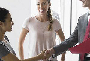 Man and woman shaking hands after discussing payment solutions for business