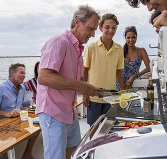 Family grilling on summer kitchen