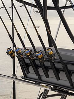 Black frame fishing rod holders on upper station
