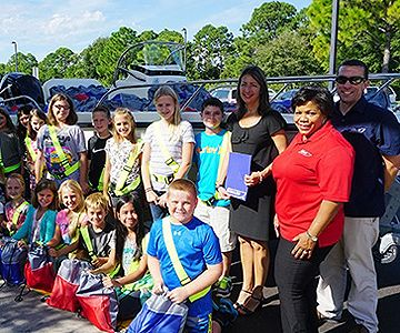 BW_2015_Boston-Whaler-Donates-a-Boatload-of-Backpacks-for-the-Fifth-Year_nw