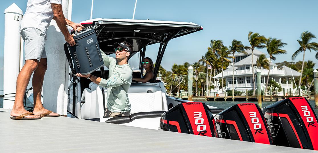 Red black metallic Mercury Racing 300 R AMS Outboard Engine dock people white black boat