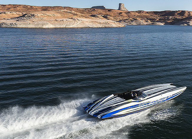 blue black white striped boat water mountains