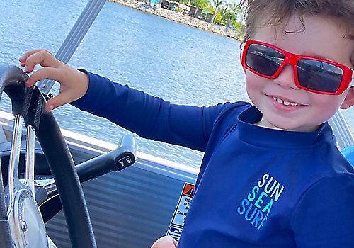 Little Boy Smiling on Boat