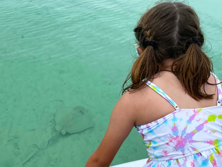 Girl Looking at Sea Ray in the Ocean