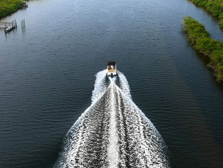 Aerial View of Boat Going Down a Canal