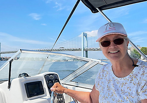 Lady Driving Boat