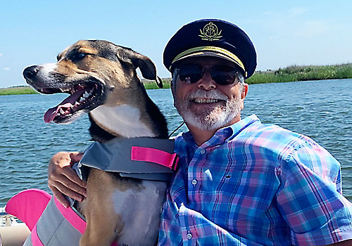 Man with His Dog on a Boat