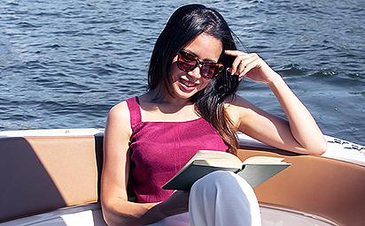 woman-reading-boat