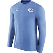 Jordan Men's North Carolina Tar Heels Heathered Carolina Blue Football Coach Dri-FIT Touch Sideline Long Sleeve Shirt