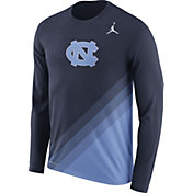 Jordan Men's North Carolina Tar Heels Navy/Carolina Blue Football Sideline Dri-FIT Long Sleeve Shirt
