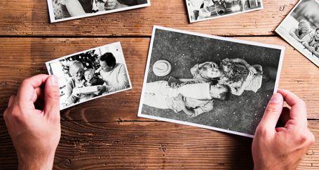 Homeowner looking at old family photos