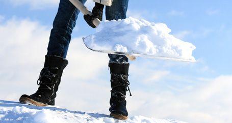 Homeowner shoveling snow