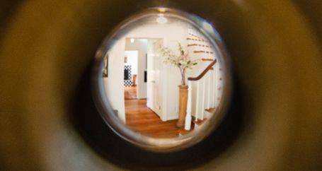 Home interior as seen through peephole